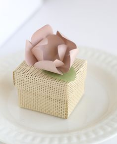 Pretty wedding favor box with pink paper flower.