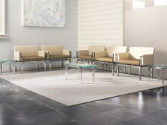 Versteel's Immix seating and CURVARE glass top tables.