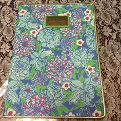 """NWOT Lilly Pullitzer tech case cover NWOT Lilly Tech case cover.  Inside reads Lilly loves the nook so I think it's for the nook.  Measures 7"""" wide and stands 10"""" tall.  Three clips hold tech in place. Lilly Pulitzer Accessories Tablet Cases"""