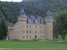 Château proche de Genève, Oyonnax France (built 1350); The domaine is composed of 254 acres, canals of free-flowing water throughout, ponds, stables, indoor riding is possible. The castle, c.1350, recently restored in 2002, can welcome 100 people in luxurious comfort. 24 bedrooms; 75,000 sq. ft. of interior space