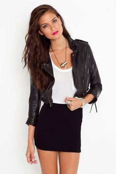 A black body con skirt such as this is a wardrobe staple for any girl headed off to college, says The Mirror's fashion columnist Andrea Butler. Read more here: http://fairfieldmirror.com/the-vine/told-by-dre-back-to-school-basics/