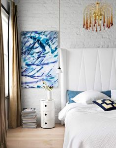 Smart Bedroom with Whitewashed Brick Wall and Over-sized Headboard