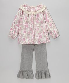 Adorable and effortless, this cotton peasant top shows off a bright and stylish print with a hippie-chic ruffled neckline. The matching pants complement the top's dreamy color scheme and ensure total comfort thanks to their stretchy fabric and elastic waistband.Includes top and pantsTop: 100% cottonPants: 95% cotton / 5...