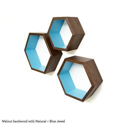 These nesting Hexagon shelves are the perfect way to add some modern geometric flair to any space! They fit inside of each other to reduce the cost of shipping, and also give you so many creative layout options. These unique wooden shelves are created by hand, finished to your
