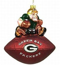 SC Sports Green Bay Packers Team Mascot Football Ornament  https://allstarsportsfan.com/product/sc-sports-green-bay-packers-team-mascot-football-ornament/  6-in NFL® team mascot ornament Made of mouth-blown glass Hand-painted in team colorsTeam mascot is perched atop a football that features the team's official logo on the front and the NFL® and Wilson® logos on the back