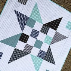 PLEASANT HOME: January 1, 2015 - Baby quilt> love the ;navy and the aqua, and the BIG star: quick and easy to make