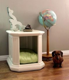 DIY Doghouse - Remove the door from an old nightstand, paint it, and add a comfy cushion, and voila - a multi-tasking nightstand / doghouse for the bedroom or livingroom... Our kitty cat would use it :)