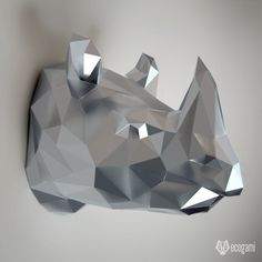 Assemble your own low poly rhinoceros trophy with our PDF template