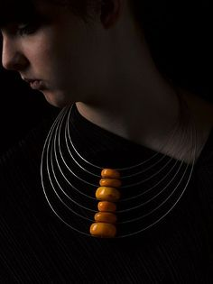 "Necklace | Linda Van Niekerk. ""Amber Traces"". Rare 'African Amber' trade beads + sterling silver"