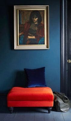 Stunning rich blue interior! With a hot orange chair. Lovely!