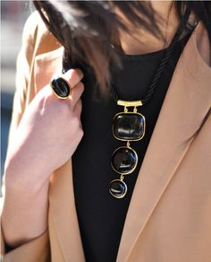 Fm 9to5chic.  Simple, bold accessories (only one or two, mind you) elevate a simple t and blazer.  Great blush color.