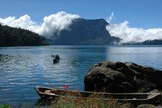 Sampan traversing the lake in Gunung Tujuh Crater Lake, Mt. Kerinci (3805 m) Kerinci - Seblat National Park | Jambi - Indonesia    By: Tim Mowrer