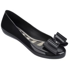 1aa156bb2254 An architectural bow adds sweet style to this flat crafted from flexible  material that conforms to your foot for added comfort.