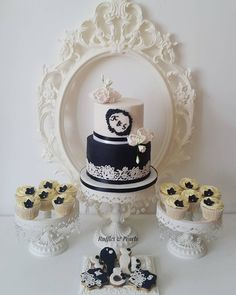 Another two tier engagement cake from the weekend with matching cookies and cupcakes requested in white and black.   #twotiercake #eastlondonbaker #engagementcookies #engagementcake #cupcakes #cakelace #crystalcandyuk #sugarflowers #sugarroses #cinipaancake #blackandwhite