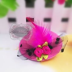 This is such a adorable Hot Pink Mini Top Hat with Flowers Feather on a alligator clip!   Measures approximately 2 1/2 Wide by 1 Tall!   Would look great on any Baby Girl or even your Puppy/Dog!  Perfect for 1st Birthdays, Birthdays, holidays, special occasions or anyday!  This also comes in lots of colors!  Be sure to check out our other items for sale!  By purchasing this item you agree to my shop policies!   Make sure you follow our Etsy Store we are constantly posting new merchandise…