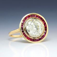 With Rubies in Rose & White Gold 2.50ctw. The setting is crafted of 14kt rose gold while the bezel mounting is in white gold. It is further accented by a vibrant halo of channel set natural calibre cut deep purplish red rubies with a total ruby weight of. 70 carats. | eBay!