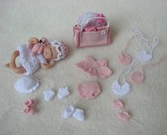 Crocheted or knitted clothes for the dolls-house baby 11/2 - 2 inches long!! Amazing!