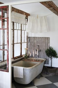 Rustic bathroom. I love the tin on the wall!