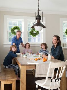 Christmas in a Sophisticated Connecticut Farmhouse. The Shillingford family—(from left) Basil, David, Orla, Digby Farmhouse Trim, Farmhouse Interior, Oak Dining Table, Dining Area, Dining Room, Interior Decorating, Interior Design, Interior Paint, Decorating Ideas