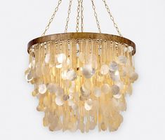 The Henry Chandelier from Made Goods features over 100 round capiz shells suspended from an antique gold metal frame. Reflective mother of pearl and translucent capiz shells are mixed to create a luminious affect. Circle Chandelier, Capiz Shell Chandelier, Coastal Chandelier, Chandelier Bedroom, Large Chandeliers, Contemporary Chandelier, Chandelier Lighting, House Lighting, Coastal Lighting