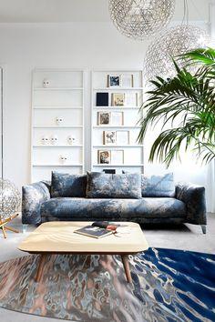 🐟JOYEUX POISSON D'AVRIL!🐟 Submergez-vous dans le monde aquatique en ce 1er avril à l'aide du Fluid Carpet de @moooi. Visitez notre site web pour plus de détails. Ottoman, Carpet, Table Lamp, Couch, Living Room, Interior Design, Chair, Furniture, Collection