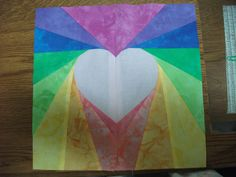Quilt block I just finished.  Paper peiced heart.  Love the hand dyed fabrics.