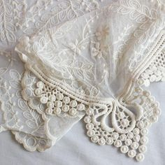 Elegant lace table runner in ivory. Use this decorative ivory cotton lace table runner to accent table centerpieces at your special event to give your wedding d