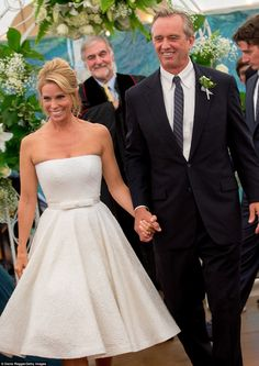 Holding hands: Walking back down the aisle to their homespun reception, Cheryl and Bobby w...