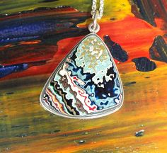 Fordite and Sterling Silver Pendant by jamesblanchard on Etsy