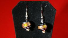 This pair of lampwork earrings is made of blue and gold glass, very elegant and stylish. They are lightweight compared to many of our