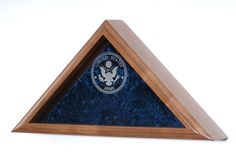 These engraved service emblem flag cases are exquisitely designed and crafted in your choice of solid oak, walnut, cherry, or mahogany. The front the case comes with double strength glass, which is engraved with your choice of service emblem: Army, Navy, Air Force, Marine Corps, or Coast Guard. The back panel of the case is layered with crushed velvet, making this the most sought after display case for all American service men and women. Continue reading →