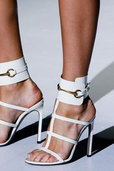 White heels. Love the shoes, but please, paint and clean your nails.