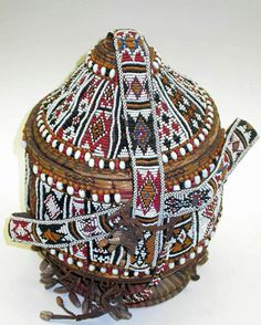 Africa | Basket from Djibouti | Raphia, tassels, shells, and red, black, and white beads.