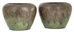 Auguste DELAHERCHE (1857-1940) A set of two potbellied enamelled stoneware vases. Signed with the artist's mark. 18-4CM / Height. 5 1-2 in. - Diam. 7 1-4 in.