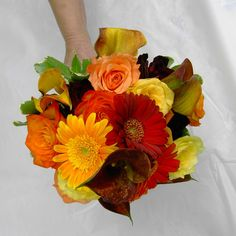 bridal bouquet, fall colors, gerber daisies, callas, and roses