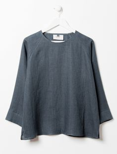 OTHER/woman Raglan Sleeve Leah Top: Limited Edition Merchant Mills for OTHER/woman Collection. Loose boxy fit with 3/4 sleeve in charcoal grey washed Linen. Raglan sleeve detail, side slits and crew neck.