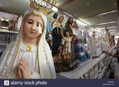 Download this stock image: Portugal, Sanctuary of Fatima (Santuário de Fátima), religious statues in the Gift Shop - GHD8TR from Alamy's library of millions of high resolution stock photos, illustrations and vectors.