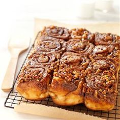 Molasses-Pecan Sticky Buns Recipe -As much as I like making yeast breads, I enjoy watching others enjoying my baking even more. These soft, tender rolls are loaded with the gooey goodness of molasses.—Shirley Saylor, Felton, Pennsylvania