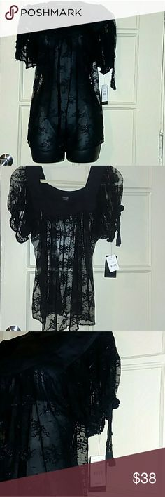 🔥Nicole by Nicole Miller black lace top🔥 size 6 black soft lace cute detail around the neck and the short sleeves. Nicole by Nicole Miller Tops Blouses