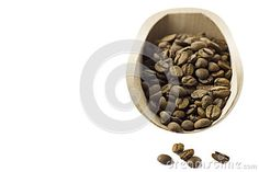 Coffee beans in the food shovel on isolated background