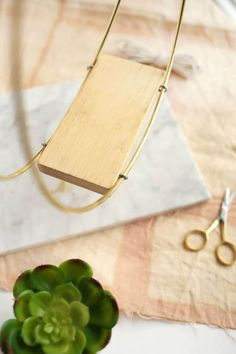 Brass Ring Hanging Planter DIY - A Beautiful Mess This specific project came to me after seeing a photo of a mid-century log holder. Hanging Plants Outdoor, Diy Hanging Planter, Diy Planters, Plants Indoor, Porch Plants, Planter Ideas, House Plants Decor, Plant Decor, Macrame Plant Hangers