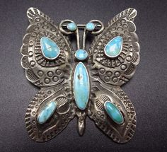 """The elegant butterfly has domed wings and 8 brilliant specimens of natural turquoise. STERLING: unmarked, verified sterling silver. MEASUREMENTS: Pin measures 1 7/8"""" x 1 5/8"""". 