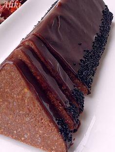 Υλικά   4 κρόκους αυγού  8 κ.σ. ζάχαρη  150 γρ. αλεσμένα ή ψιλοκομμένα καρύδια  120 γρ. αλεσμένα μπισκότα  100 γρ. σοκολάτα κουβερτούρα ...