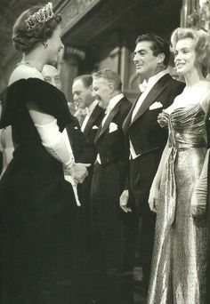 Marilyn Monroe meeting Queen Elizabeth II at The Empire Theatre in London, 29th October 1956.  .