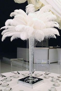 Tall Lily Vase filled with clear or coloured gel with 25 pure ostrich feathers and 4 crystal drops lit using a wireless LED light system in the base. Gatsby Theme, Great Gatsby Wedding, Art Deco Wedding, Feather Wedding Decor, 1940s Wedding Theme, Wedding Flowers, Ostrich Feather Centerpieces, Feather Wedding Centerpieces, Feather Decorations