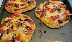 """Set up your own """"make-a-pizza"""" bar with all the toppings you want to offer, and the kids can make their own."""