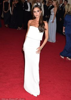 Making her mark: Victoria wowed in an elegant column dress from her own collection - the theme of the night was 'White tie'