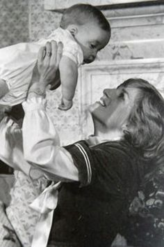Darling shot of Princess Diana holding Prince William up