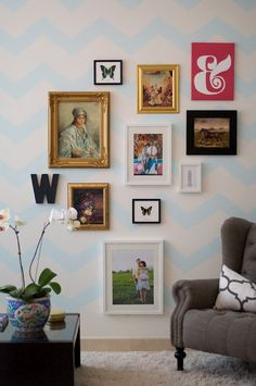 chevron gallery wall. like the heavier gold frames. small scale