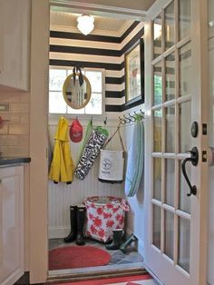 small mudroom, bold wallpaper adds visual interest!